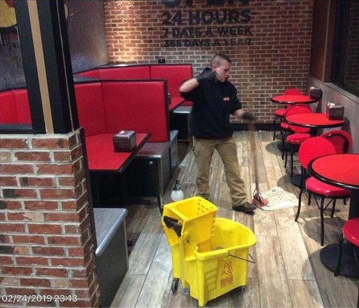 SERVPRO technician with mop in eatery