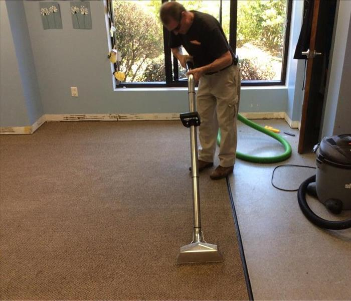SERVPRO tech with water extraction equipment