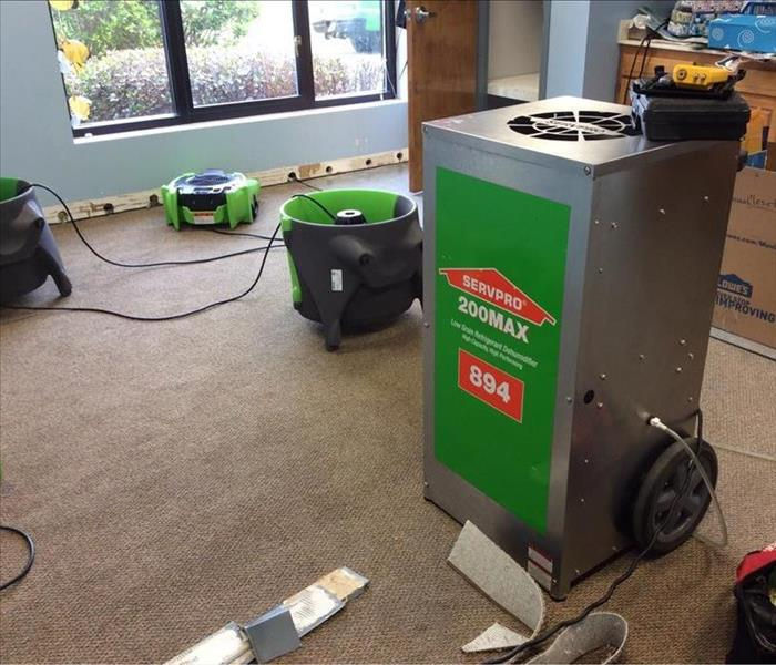 Room with different types of SERVPRO drying equipment